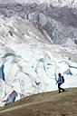 Norway, Nigardsbreen, Woman hiking across glacier tongue - MR01197