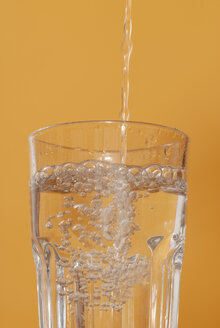 Water being poured into glass, close up - KJF00032