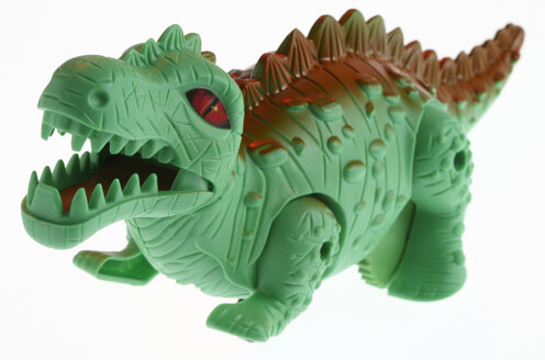 Toy plastic dinosaur against white background - THF01049
