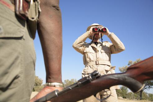 Africa, Botswana, Okavango Delta, Men on Safari - PK00340