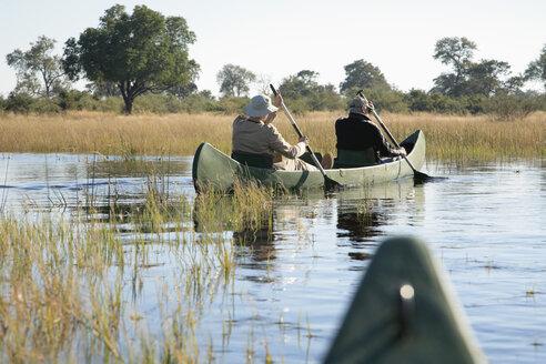 Africa, Botswana, Okavango Delta, Men in canoe - PK00337