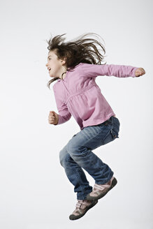 Girl (4-5) jumping, side view, portrait - LDF00610