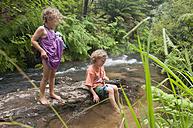 New Zealand, Rotorua, Kerosene Creek, Two Children (4-5) (6-7) on riverbank - SHF00389