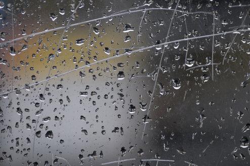 Raindrops on window pane, close-up - AWDF00347