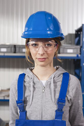 Germany, Neukirch, Young woman wearing hardhat and safety glasses, portrait - WESTF11880