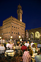 Italy, Tuscany, Florence, Palazzo Vecchio at night, sidewalk cafe in foreground - PSF00269