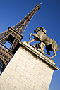 France, Paris, Eiffel Tower, Pont d'Lena, Statue in foreground, low angle view - PSF00155