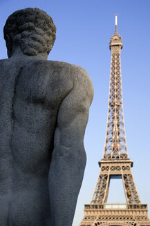 France, Paris, Eiffel Tower, Stone sculpture in foreground - PSF00152