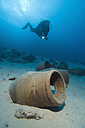Egypt, Red Sea, Scuba diver and amphoras on ocean bed - GNF01158