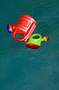 Germany, Baden-Württemberg, Plastic watering can floating in pool - SMF00455