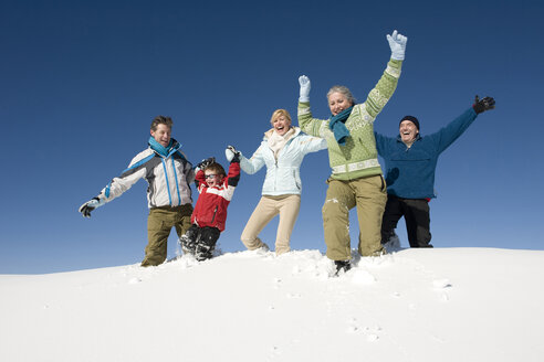 Italy, South Tyrol, Seiseralm, Family in snow, having fun - WESTF11428