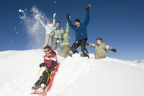 Italy, South Tyrol, Seiseralm, Family in snow, having fun - WESTF11419