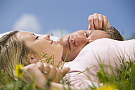 Germany, Bavaria, Munich, Young couple lying in meadow - CLF00717