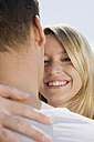 Germany, Bavaria, Munich, Young couple embracing, smiling, portrait, close-up - CLF00702