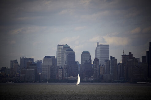 USA, New York City, Manhattan skyline seen across water - TL00343