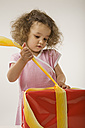 Girl (2-3) unwrapping present, portrait - LDF00689