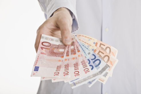 Person holding Euro notes - LDF00714