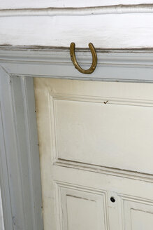 Horseshoe on wall above door - AWDF00400