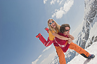 Austria, Salzburger Land, Couple having fun, man carrying woman, laughing portrait - HHF03067