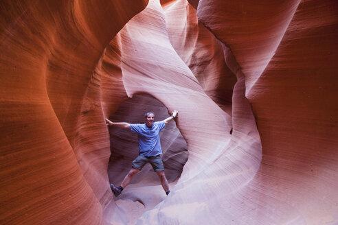 USA, Arizona, Man standing in Lower Antelope Canyon - FOF01603