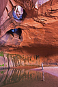 USA, Utah, Grand Staircase-Escalante National Monument, Neon Canyon, Tourists in Golden Cathedral - FOF01669
