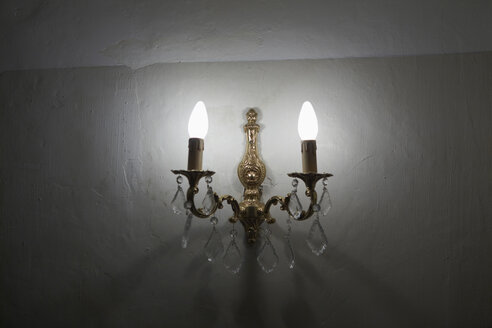 France, Candelabra on wall, close-up - TLF00368