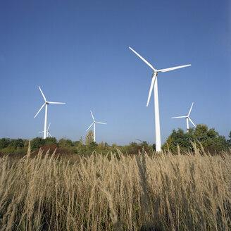 Germany, Rüdersdorf near Berlin, Wind wheels in field - PMF00809