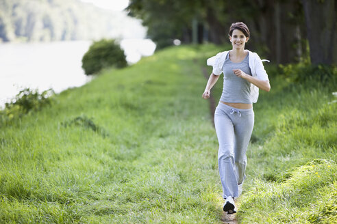 Germany, Bavaria, Young woman jogging - MAEF01882