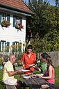 Germany, Bavaria, Friends eating in the garden - WESTF13273