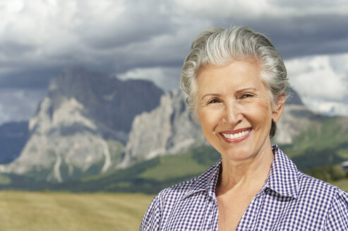 Italy, Seiseralm, Senior woman smiling, portrait, close-up - WESTF13422