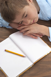 Schoolboy (6-7) sleeping at desk, elevated view - KJF00072