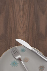 Knife and fork on plate, elevated view - KJF00066