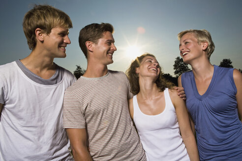 Germany, Bavaria, Young people side by side, laughing, portrait - LDF00808