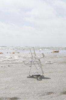 Germany, Schleswig Holstein, Amrum, Toy Windmill on sandy beach - AWDF00429