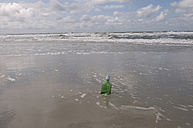 Germany, Schleswig Holstein, Amrum, Message in a bottle on the beach - AWDF00420