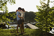 Germany, Berlin, Young Couple embracing by River Spree, view - VVF00081