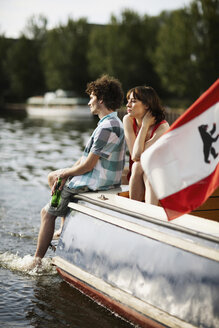 Germany, Berlin, Young couple on motor boat - VVF00066
