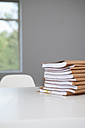 Stack of files in conference room - JRF00144