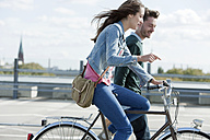 Germany, Berlin, Young couple with bicycle - WESTF13955
