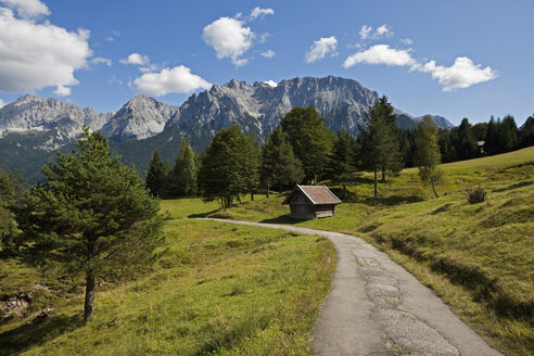 Germany, Bavaria, Mittenwald, Hiking trail with Karwendel mountains in background - FOF02022