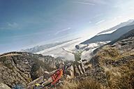 Austria, Steiermark, Reiteralm, Hikers resting in mountains - HHF03155