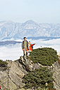 Austria, Steiermark, Reiteralm, Hikers in mountains, woman pointing - HHF03152