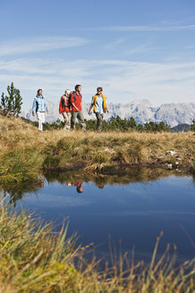 Austria, Salzburger Land, Four hikers in landscape - HHF03107