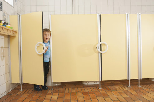 Germany, Boy (4-5) standing in restroom, portrait - RNF00204