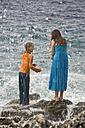 Croatia, Korcula, Girls (8-13) enjoying at seashore - GNF01185
