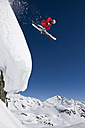 Austria, Salzburger Land, Gerlos, Skier jumping from Mountain, side view, elevated view - FFF01111