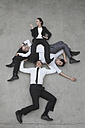Businessman lifting colleagues, elevated view - BAEF00073