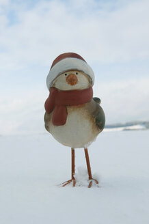 Clay duck with santa hat standing in snow, wnter. - AWDF00494