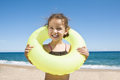 France, Corsica, Girl (2-3) wearing inner tube, smiling, portrait - SSF00053