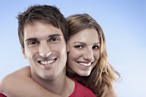Woman embracing man, smiling, portrait - SSF00035
